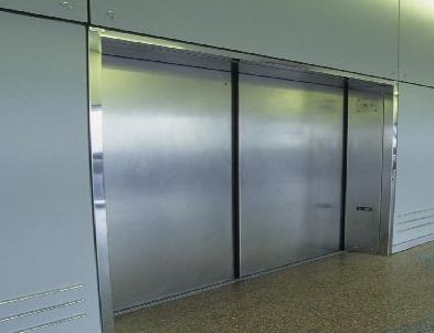 silver elevators in hallway