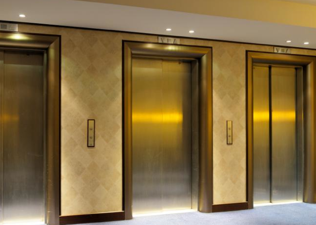 picture of three gold elevators